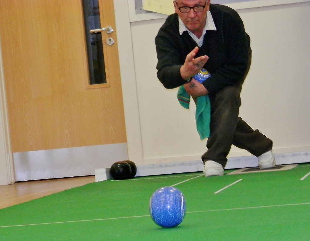 A more experienced bowler in action